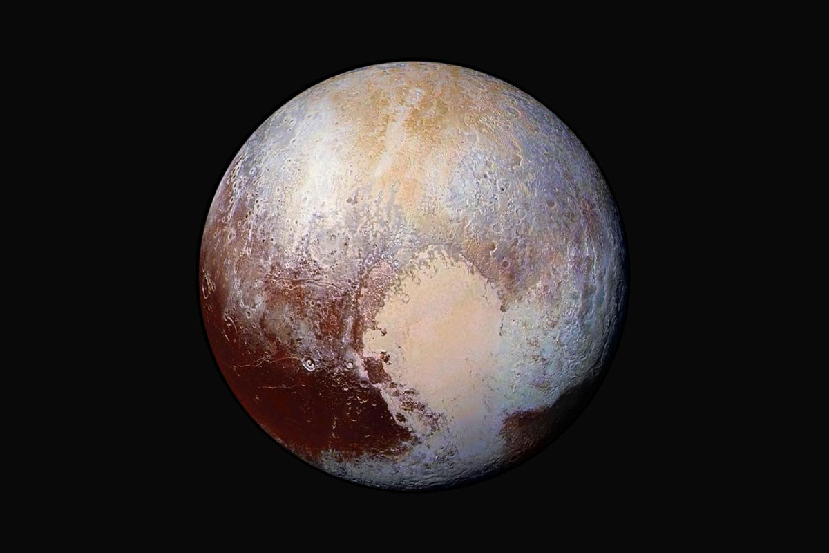 Pluto in space, with brown, beige and hints of blue coloring in the sphere