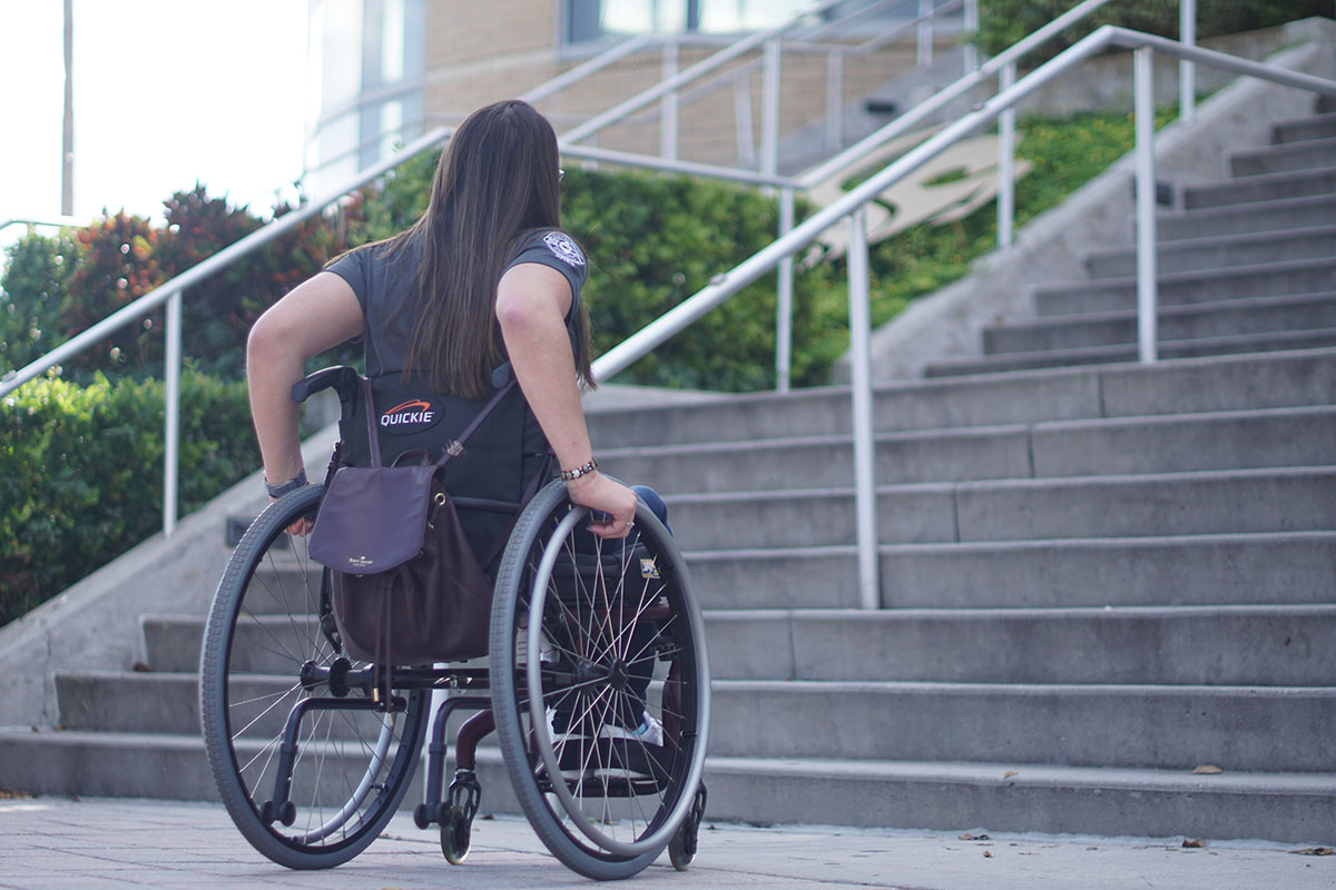 Katherine Torres approaching stairs in her wheelchair.