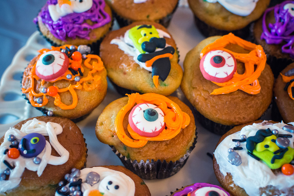 cupcakes with fake eyeballs and orange frosting