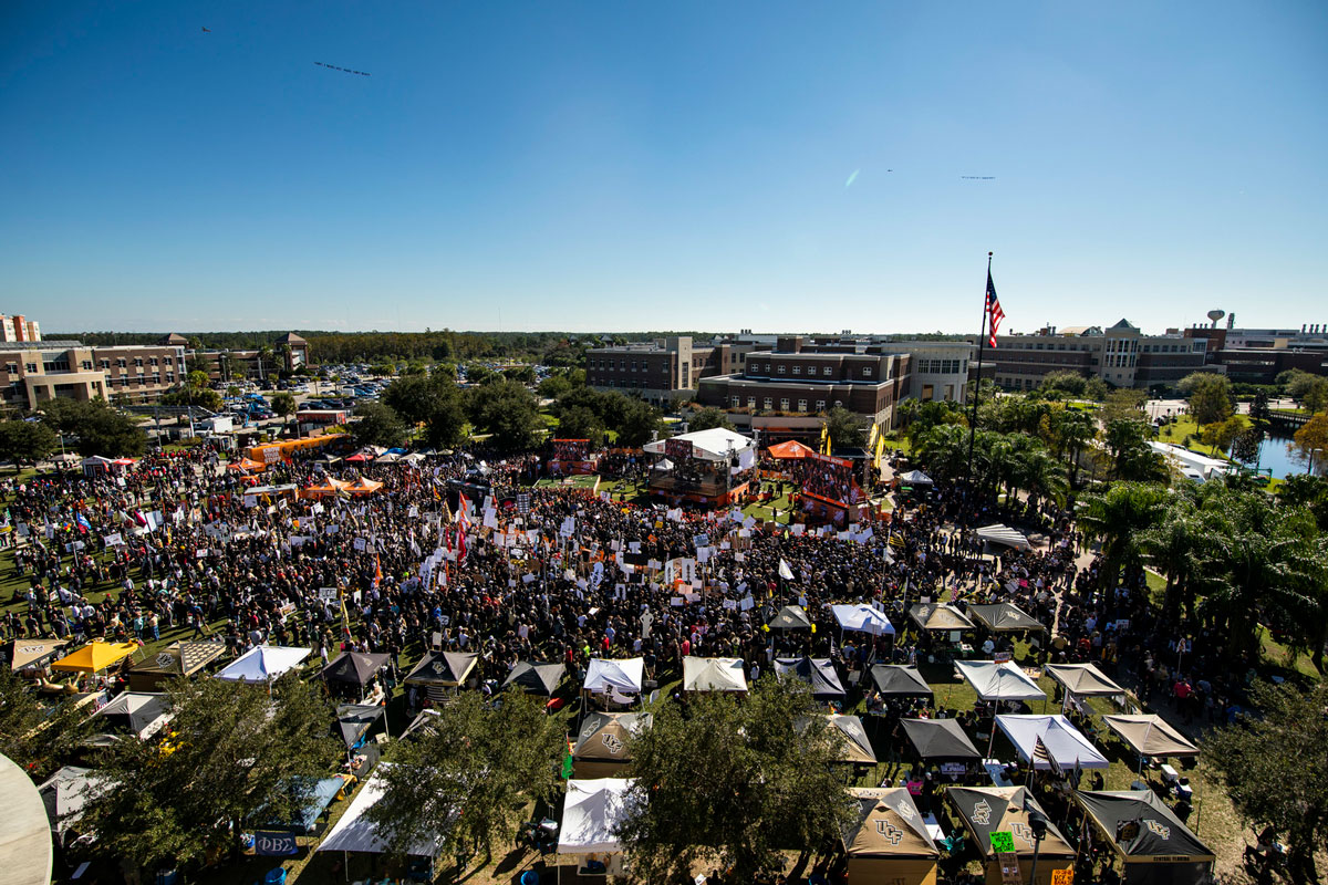 wide shot of crowd around College GameDay set on Memory Mall on blue, cloudless day