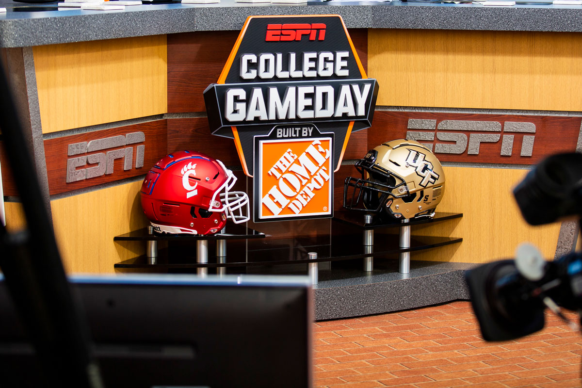 College GameDay desk and UCF and Cincinnati helmets