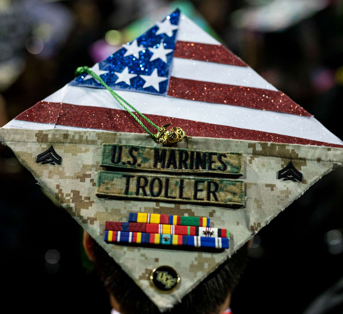 Graduation cap decorated with American flag and U.S Marines service ribbons