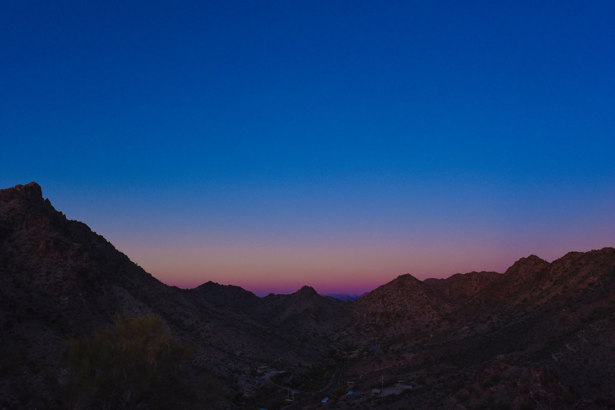 Jeweled tone sky with dusty mountains
