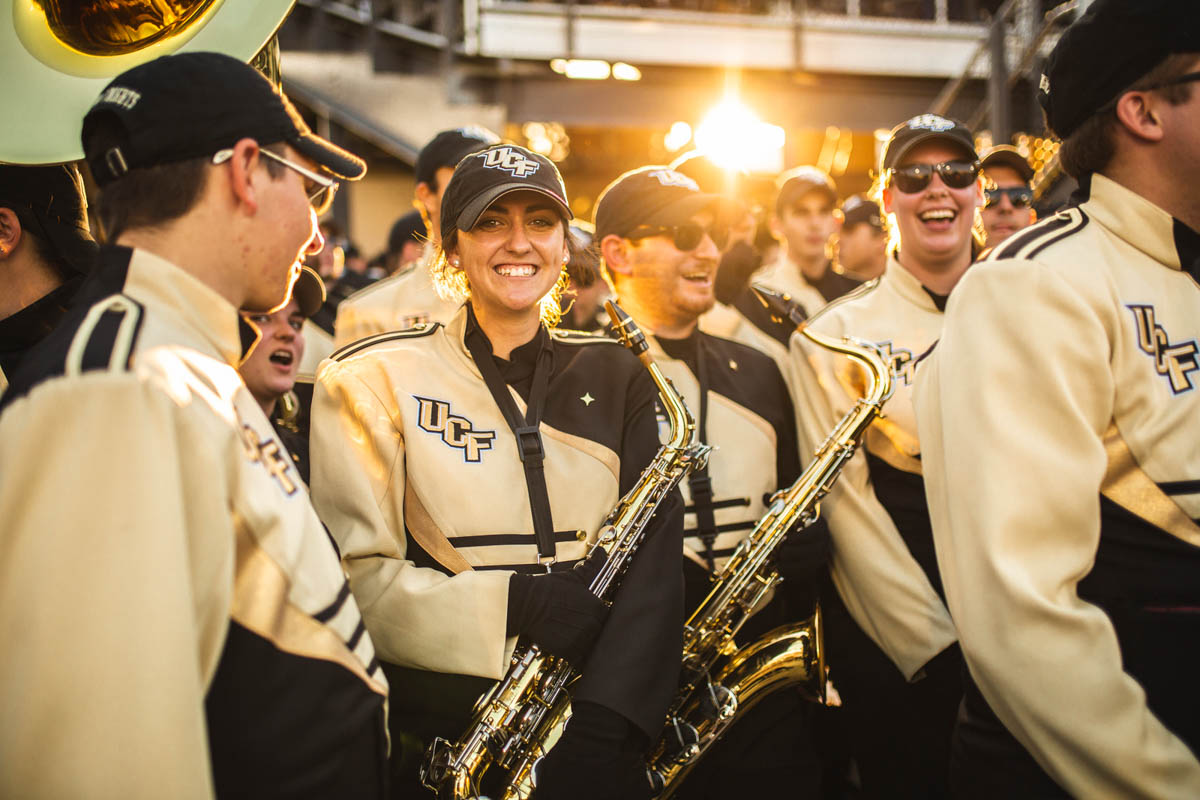 The Marching Knights get ready to perform on the football field during half-time at the game against Florida Atlantic University.