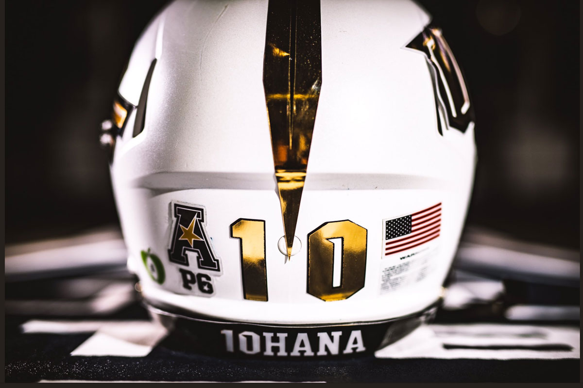 backside of white football helmet with a gold 10 and 10HANA written along the bottom