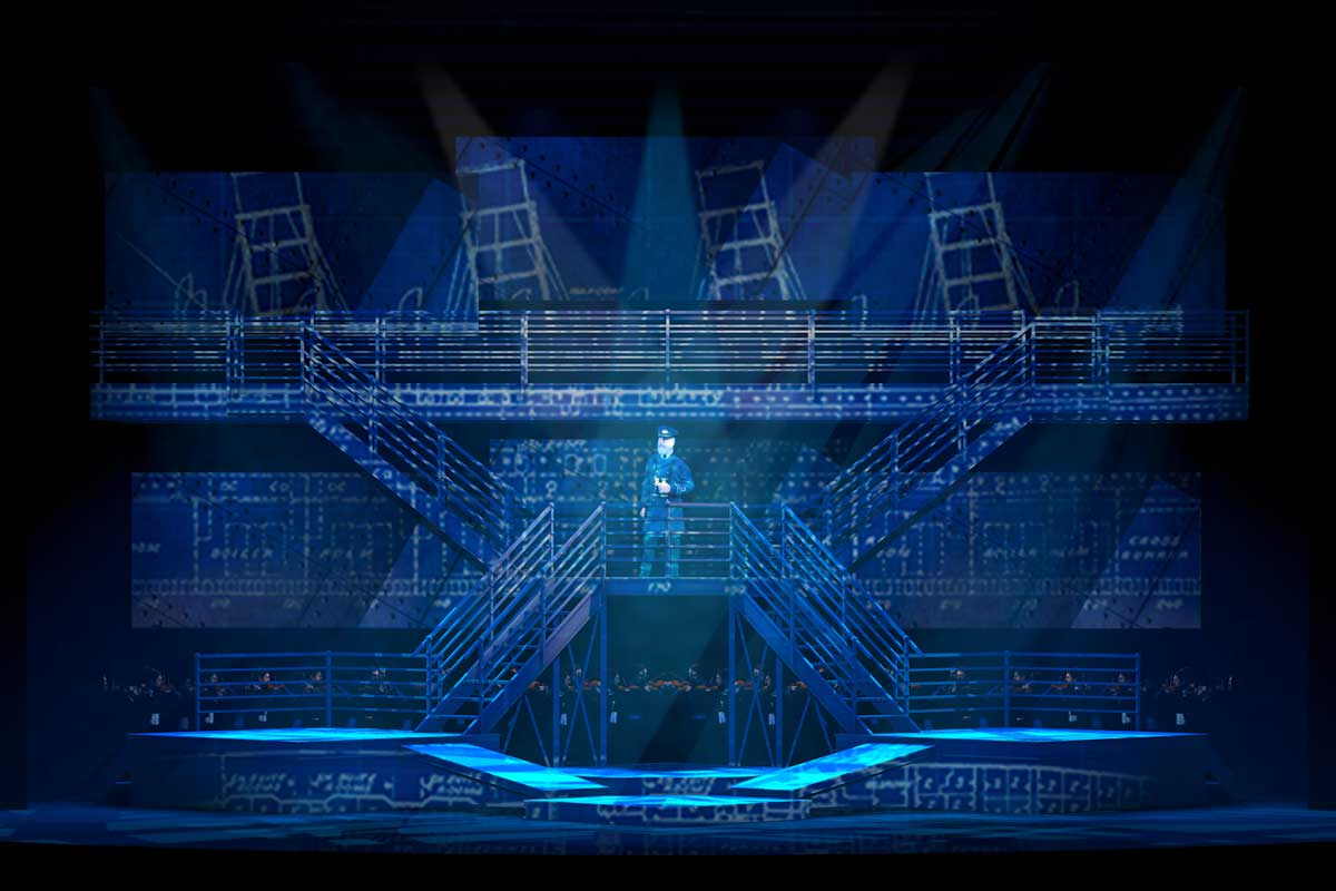 Blue stage set with a captain of a ship on a set of stairs