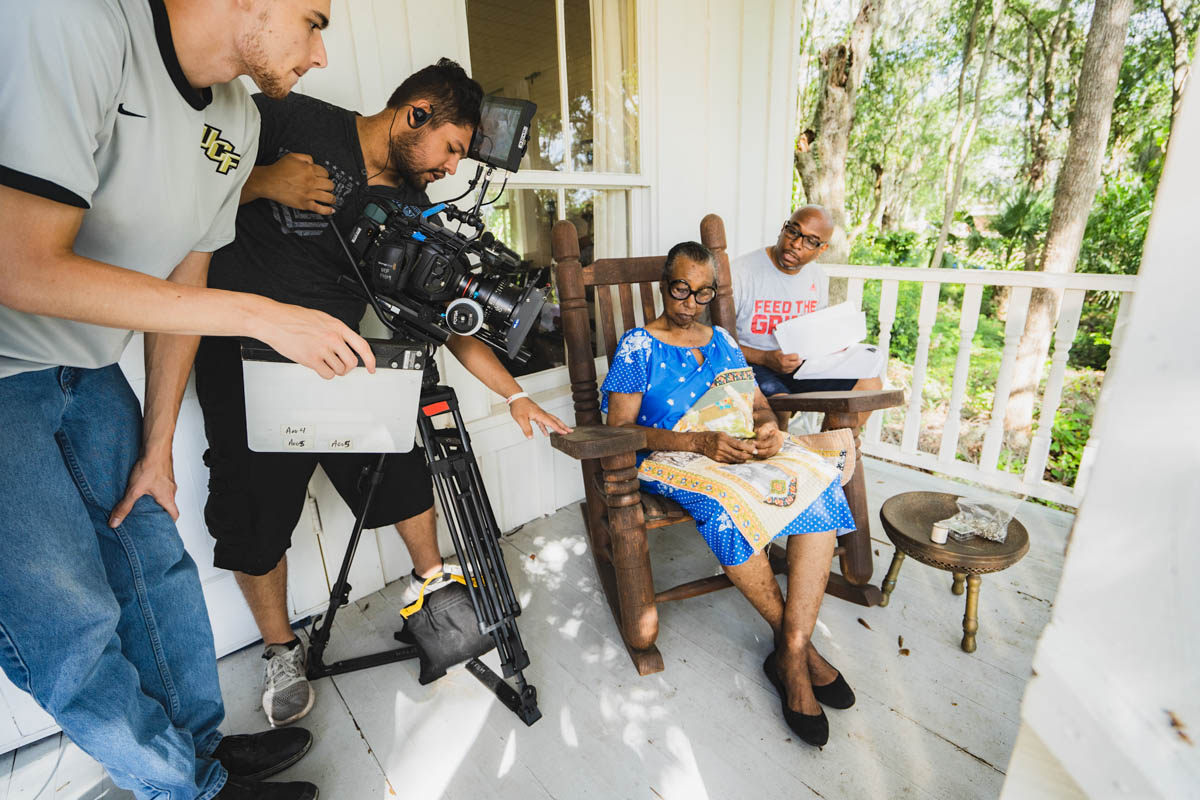 """Graduate student Jason Gregory (right) helps set up a shot during the filming of his TV pilot """"Waking Up White."""" (Photo courtesy of Jason Gregory)"""