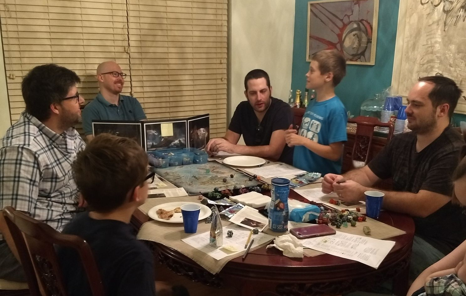 Gamers sitting around a table and playing Dungeons & Dragons