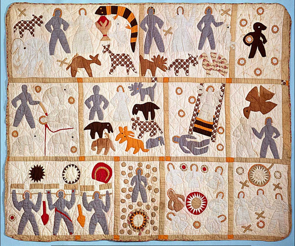 Tan quilt with panels of stitched figures acting out bible scenes