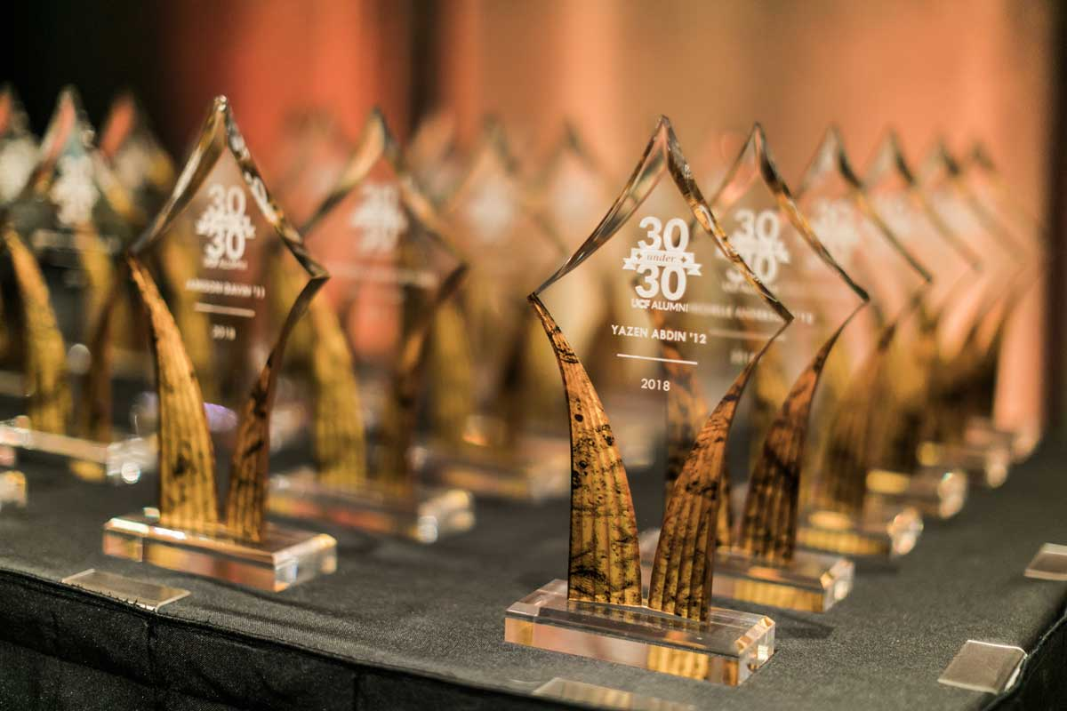 glass awards in rows on a table