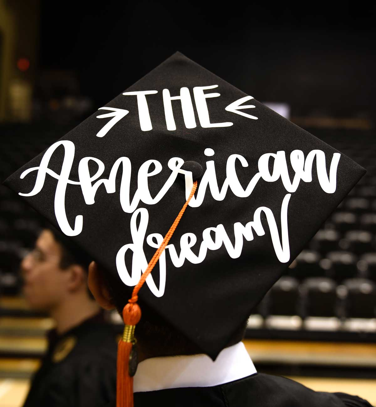 Grad cap decorated with text: The American Dream