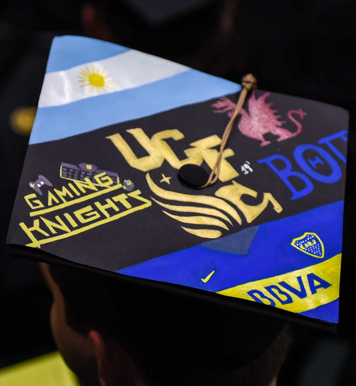 Grad cap decorated with Gaming Knights and UCF pegasus logo