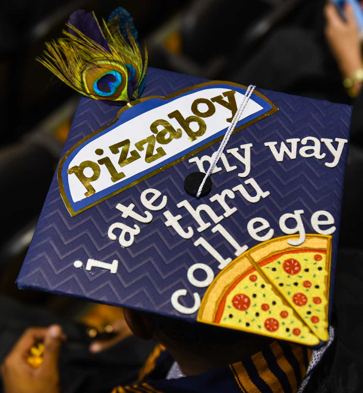 Grad cap decorated with text: Pizzaboy I ate my way thru college