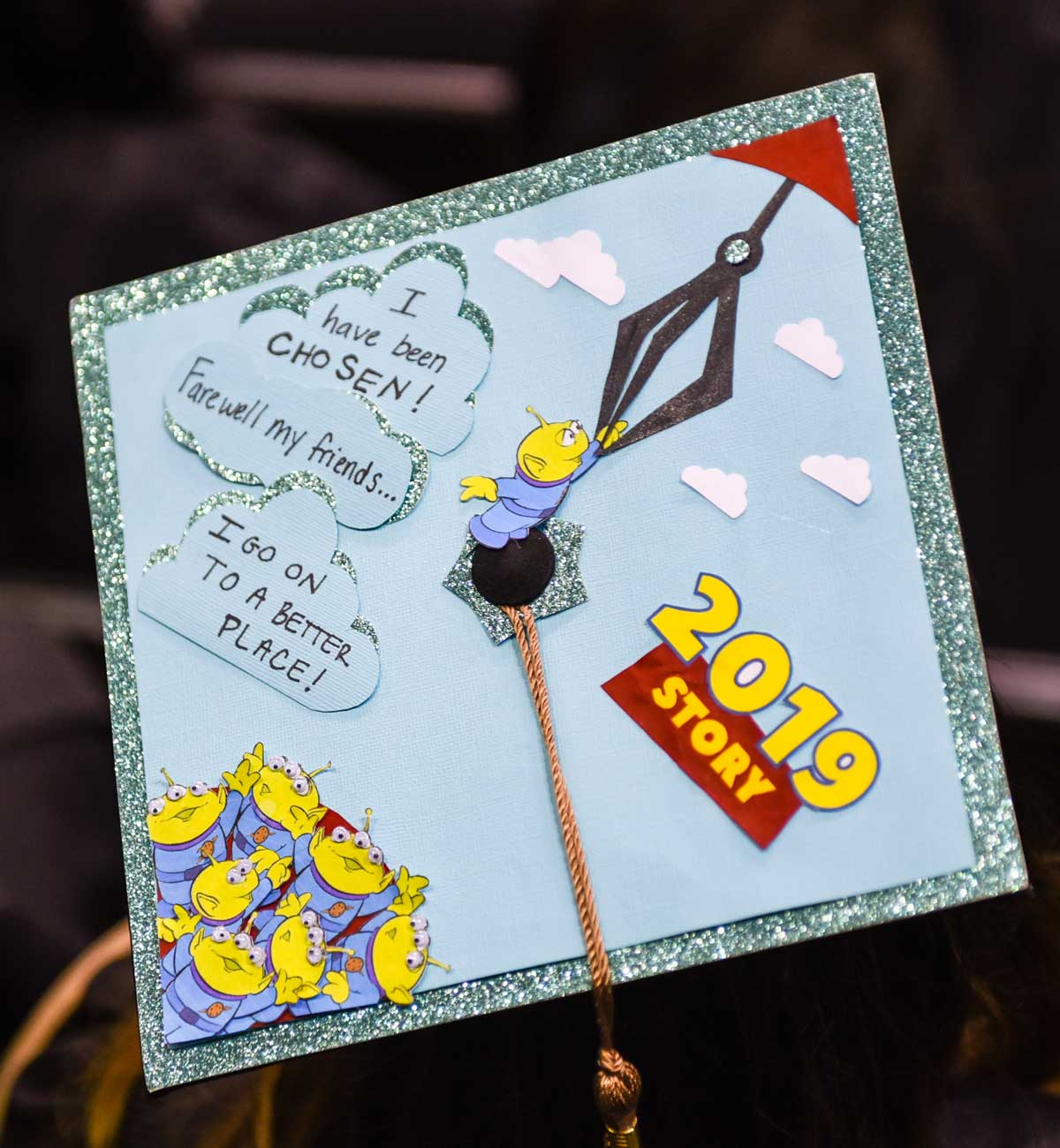 Grad cap decorated with Toy Story aliens