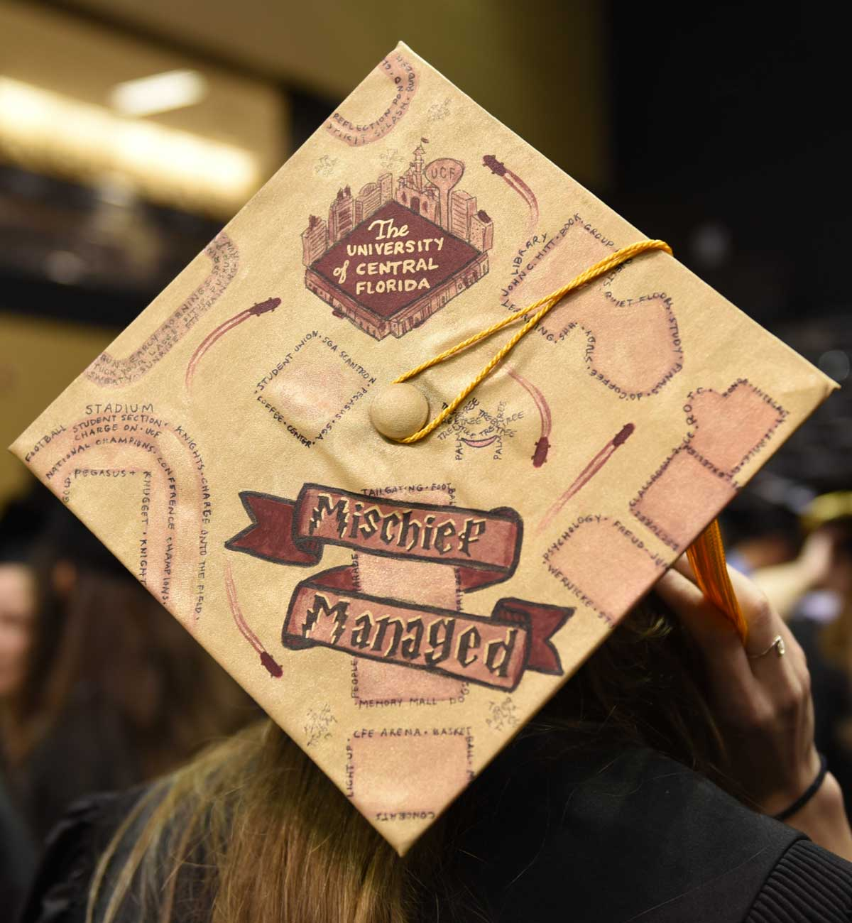 Grad cap decorated with Harry Potter's Marauders Map