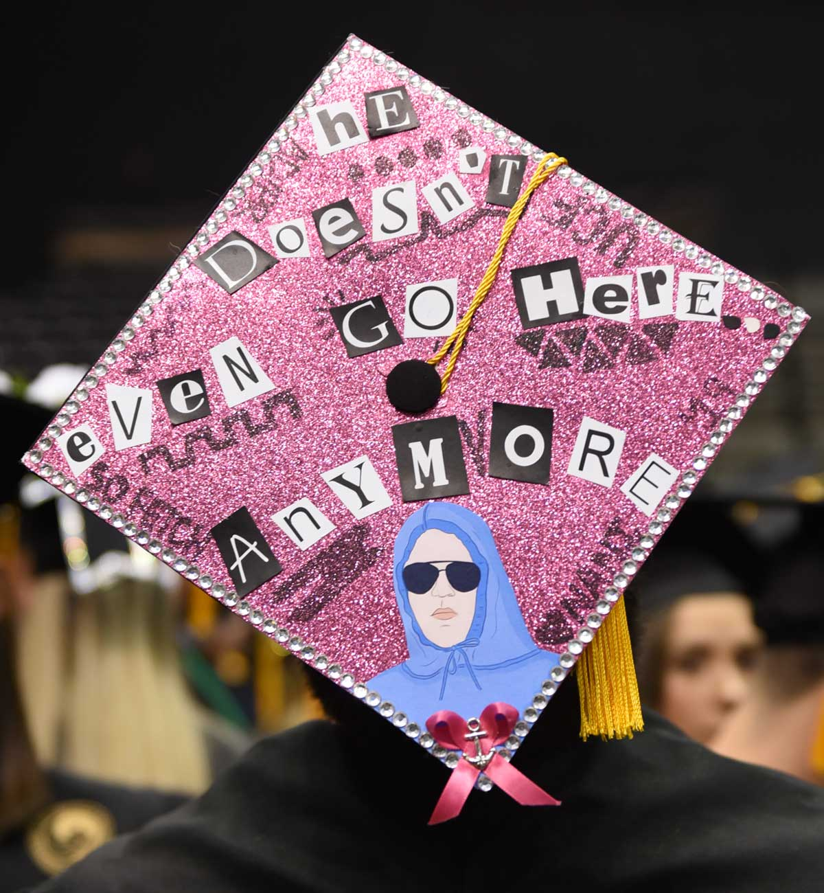 Grad cap decorated with Mean Girls quote: He doesn't even go here anymore