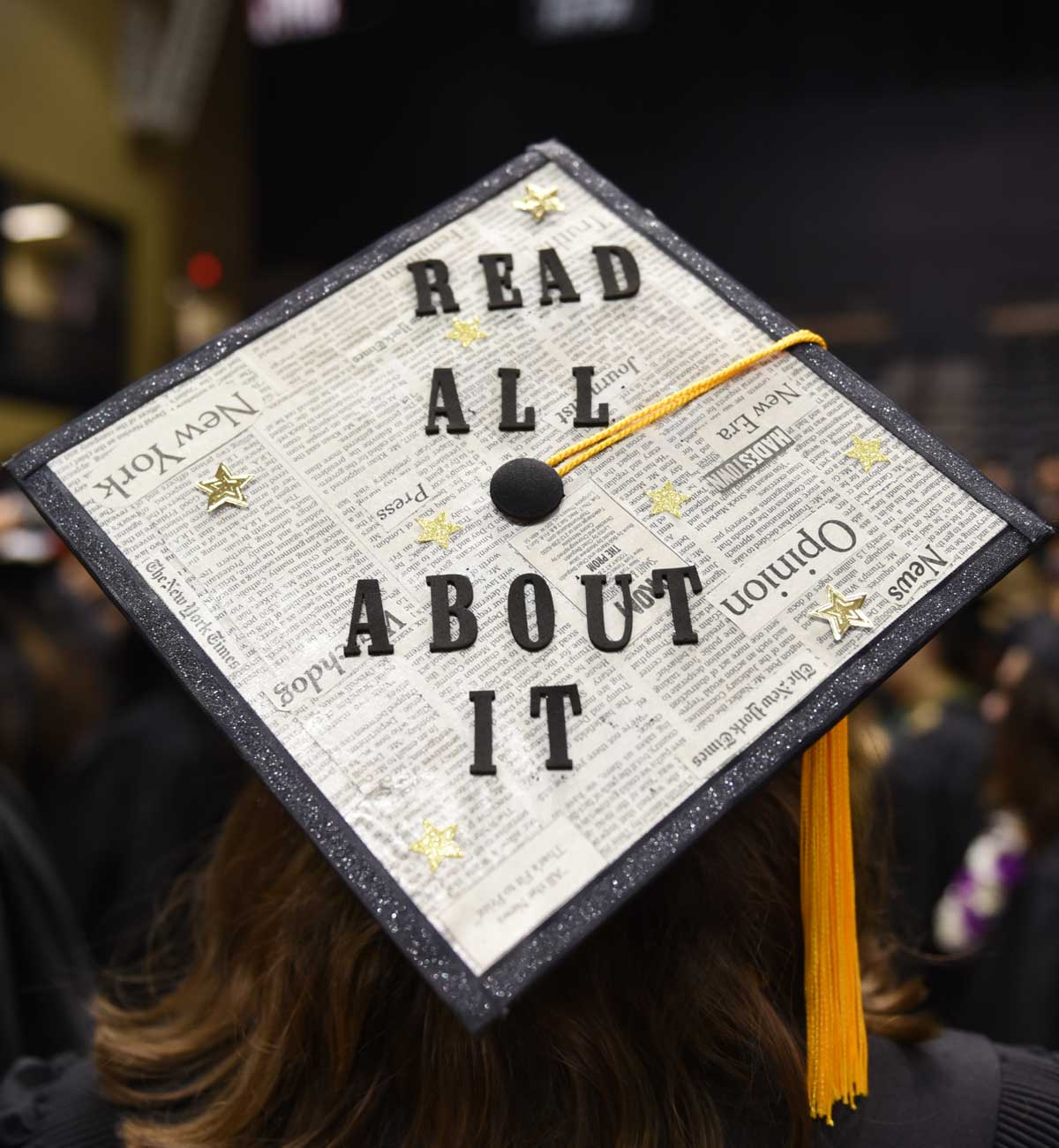 Grad cap decorated with newspaper and text: Read all about it