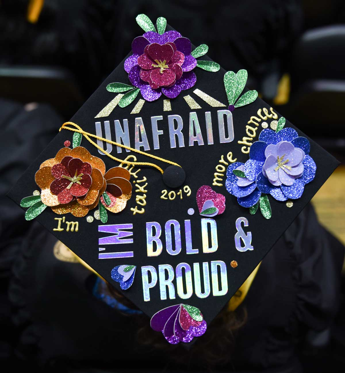 Grad cap decorated with text: Unafraid I'm bold & proud
