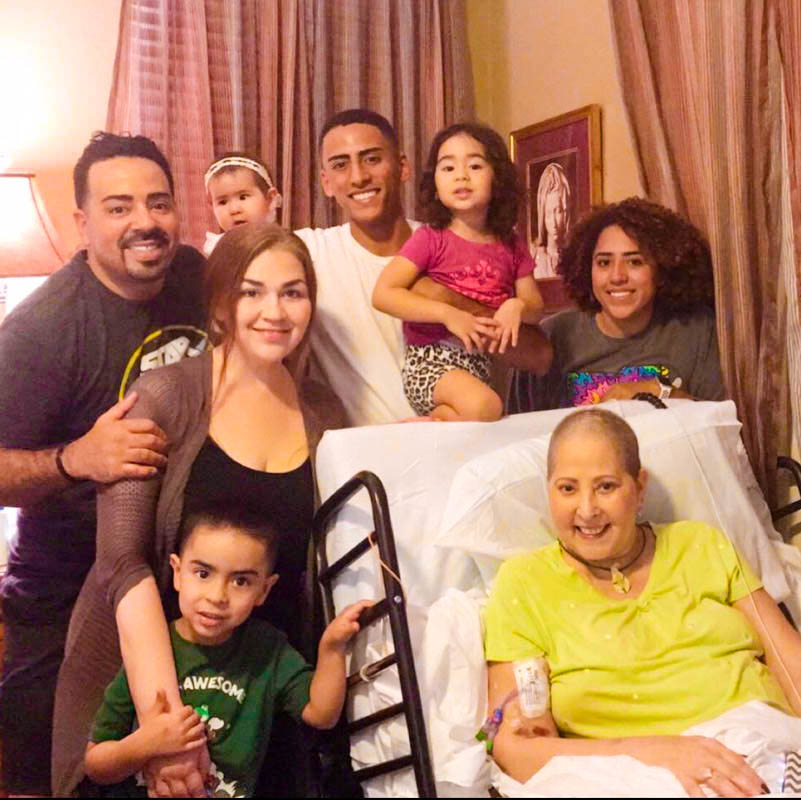 Maribel Ortiz-Pina's eldest son Pedro Morrero (left) and his family visit his mother. Ortiz-Pina's two other children, Julian (center) and Julisa Pina (right), are also pictured here.