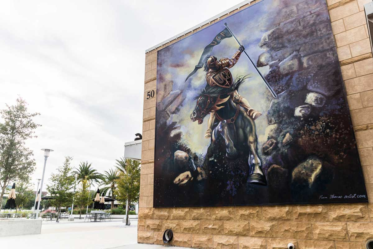 mural of Knight riding a horse and breaking through a brick wall