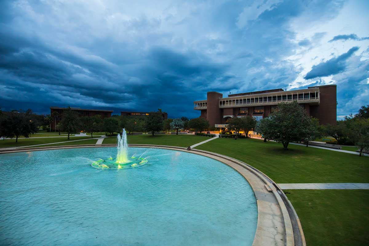 Storm clouds roll in over UCF's Reflecting Pond and John C. Hitt Library