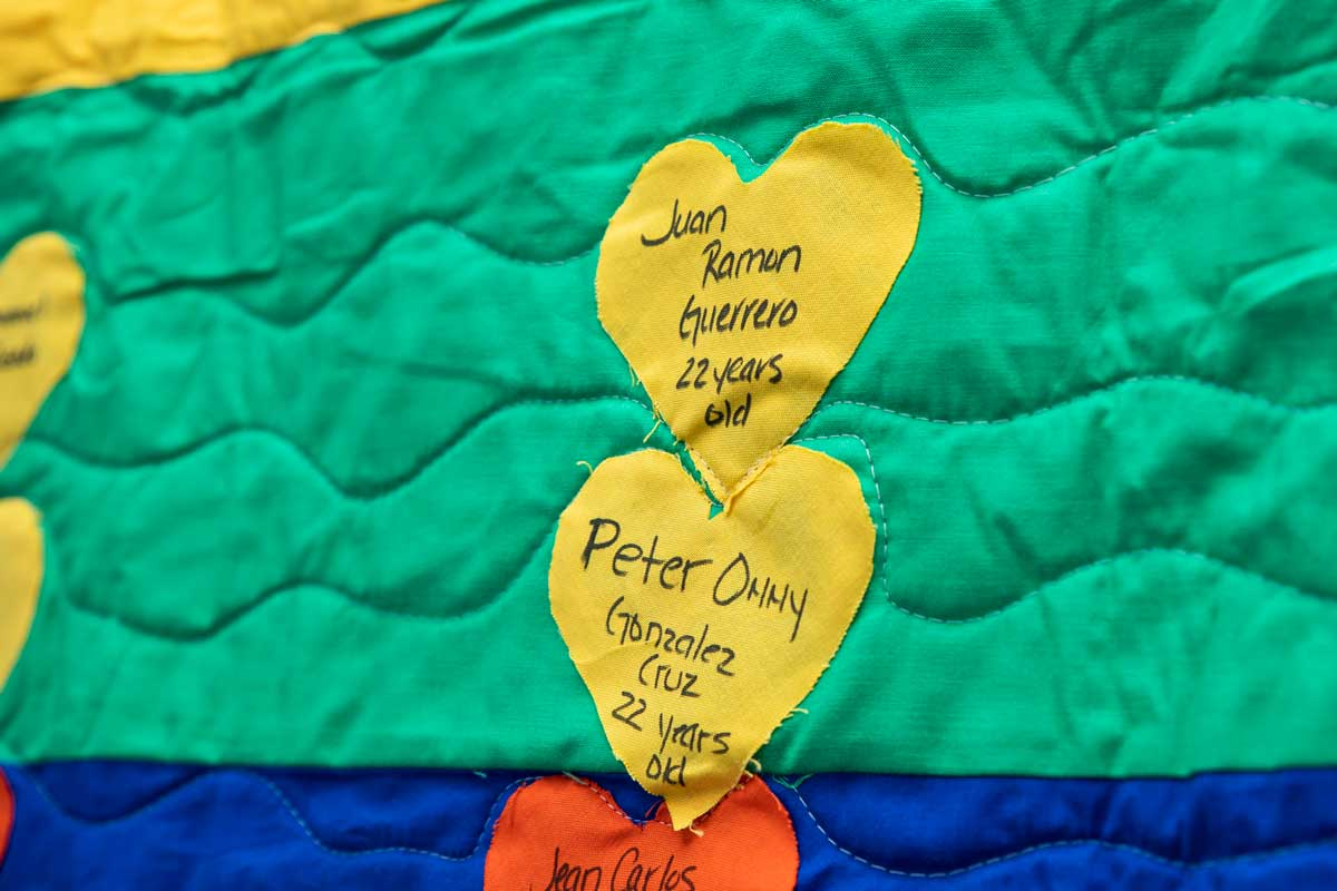 yellow hearts stitched on a green and blue quilt