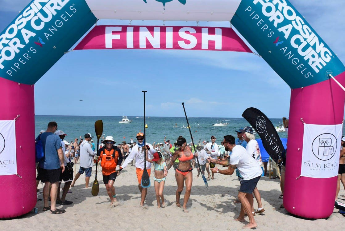Paddlers crossing finish line