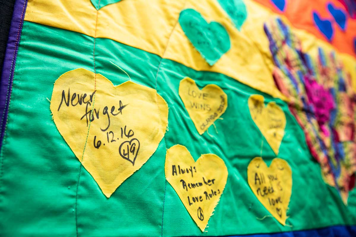 yellow hearts stitched on green quilt fabric