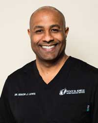 African-American man in black medical scrubs