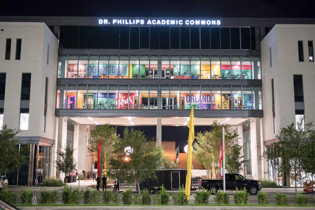 Dr. Phillips Academic Commons building lit up at night
