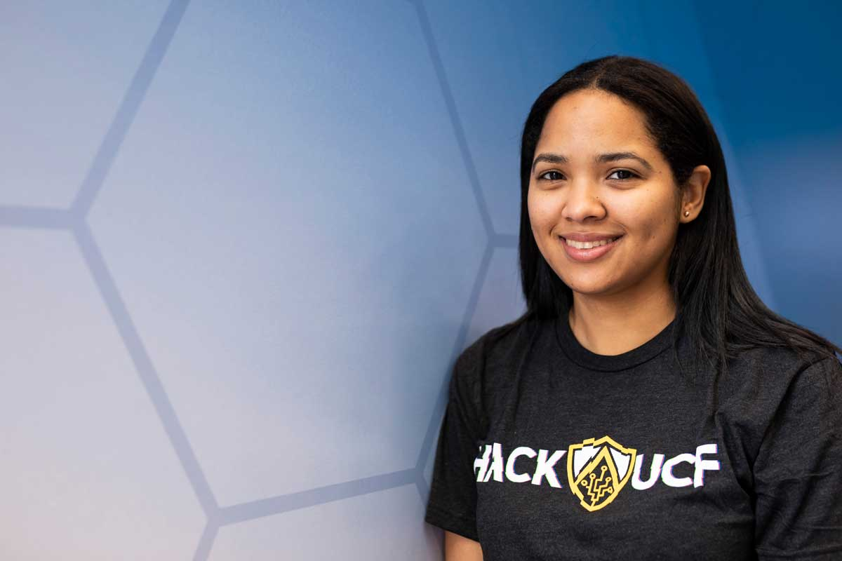 Female with dark hair wearing a Hack UCF black T shirt