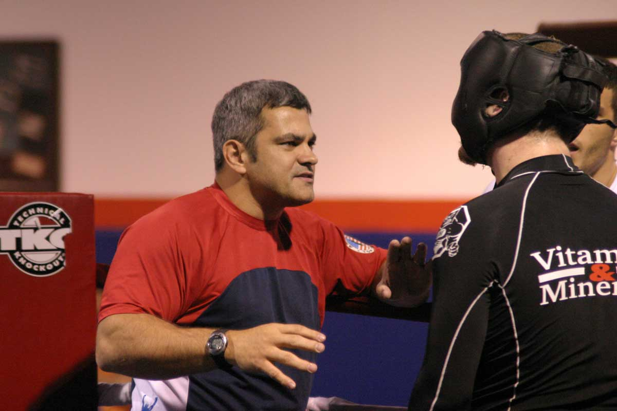 Ricardo Liborio coaches man in black headgear