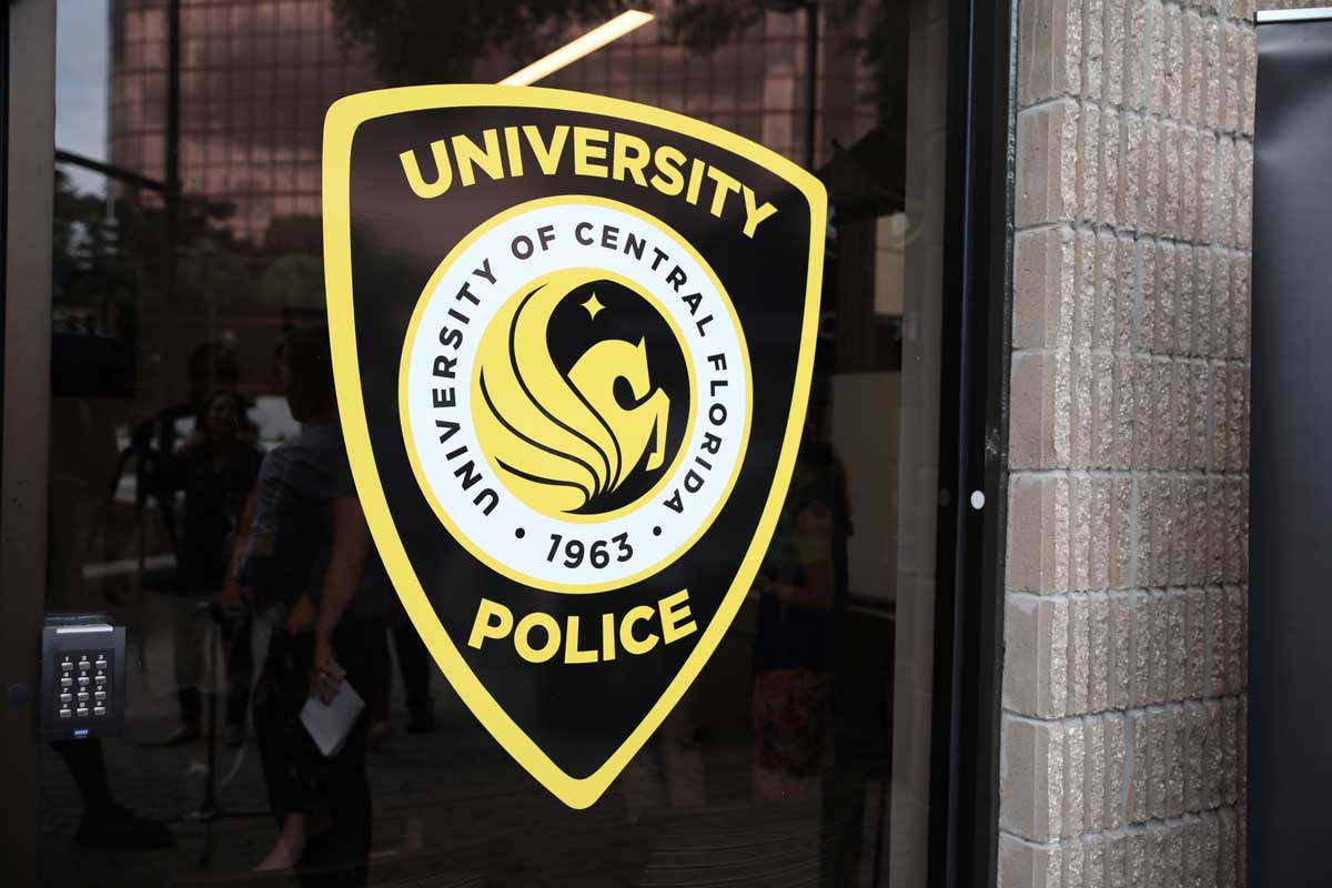 University of Central Florida police logo on glass window of office building