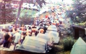 line of cars and people at Woodstock