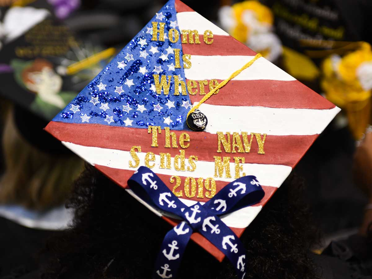 Decorated grad cap: Home is where the Navy sends me