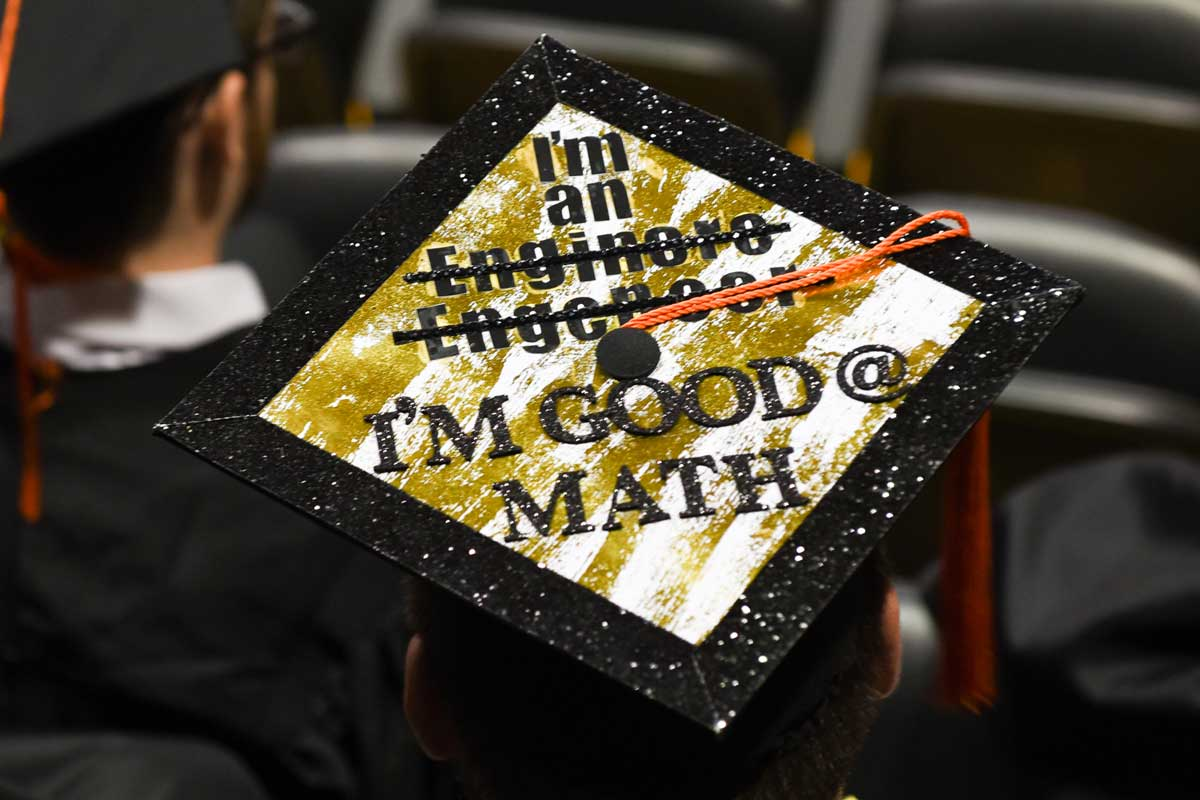 Decorated Grad Cap: I'm an [two crossed out mispellings of engineer] I'm good @ math