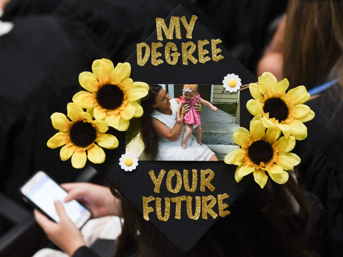 decorated grad cap: My degree, your future with photo of mom and baby daughter