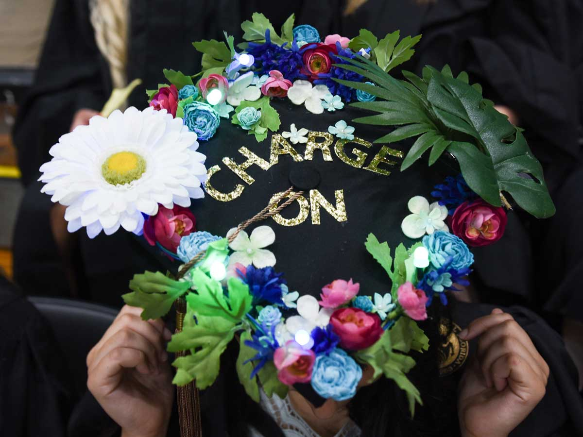decorated grad cap with flowers: Charge On