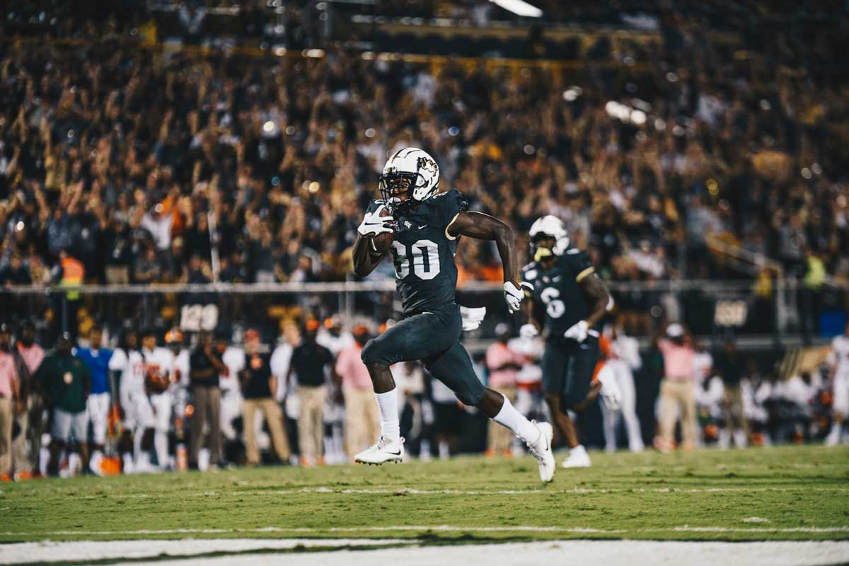 UCF running back Greg McCrae sprints toward the end zone