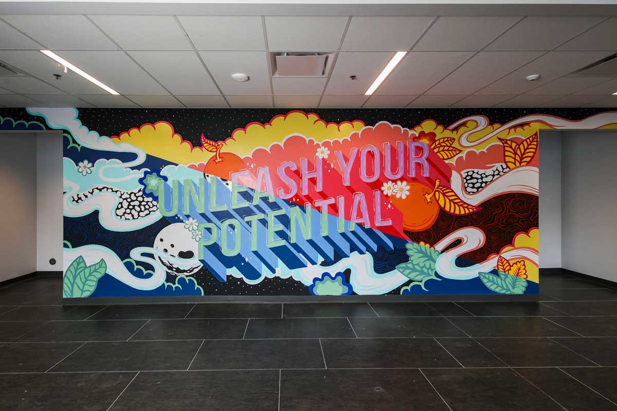 colorful wall mural with words: Unleash Your Potential