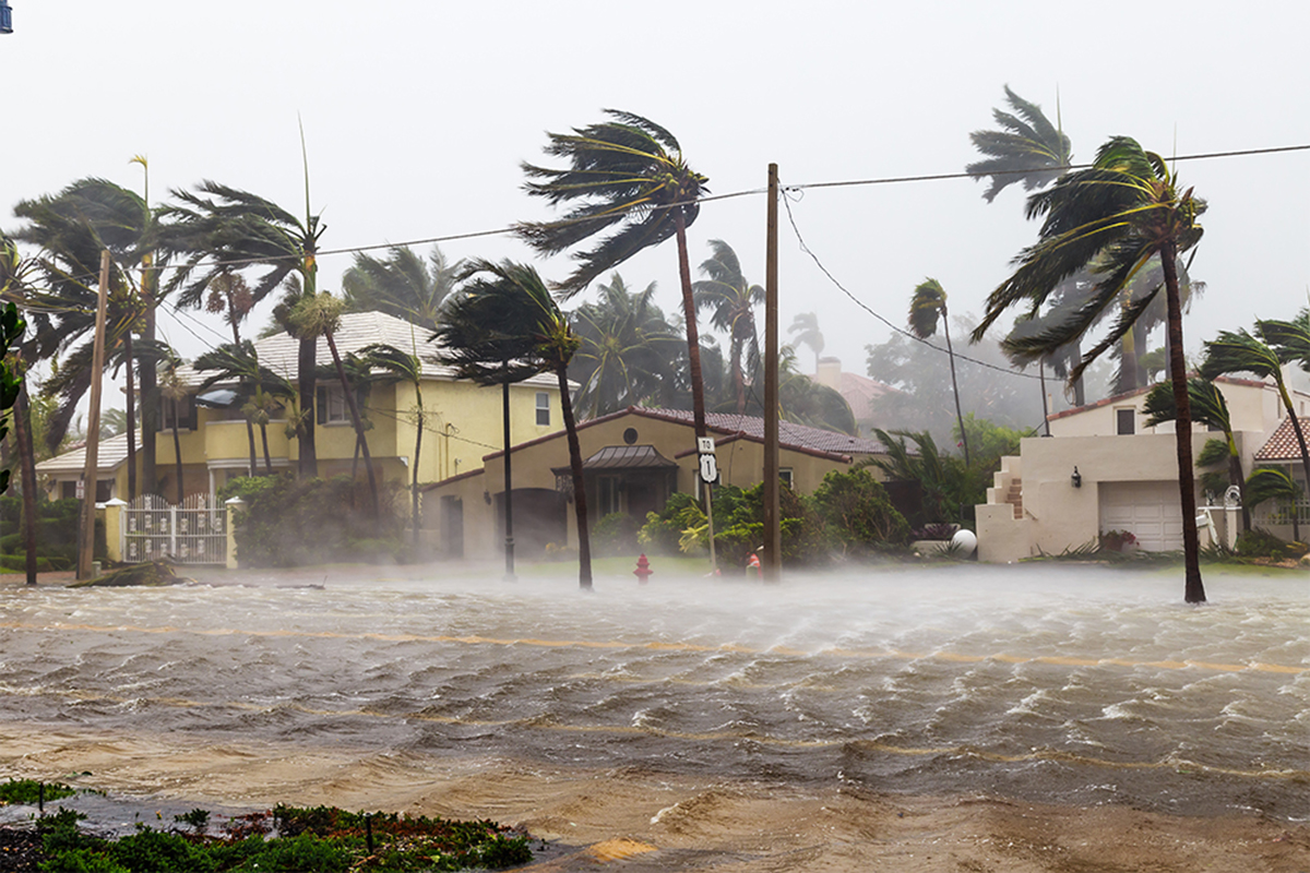 High winds and floods are threatening a residential area.