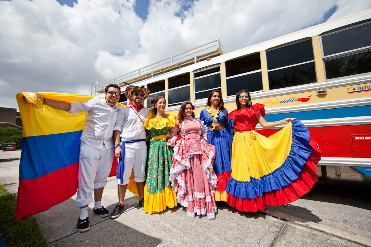 Students dressed in colorful clothing from home countries.