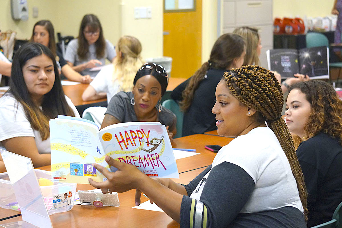 UCF elementary education students work with high school students from Tavares Teaching Academy