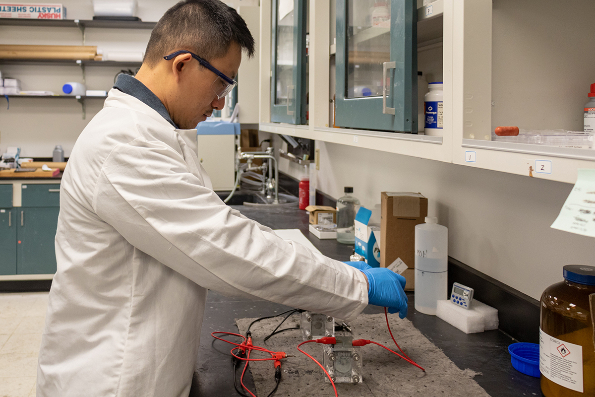 Yang Yang works in his lab.