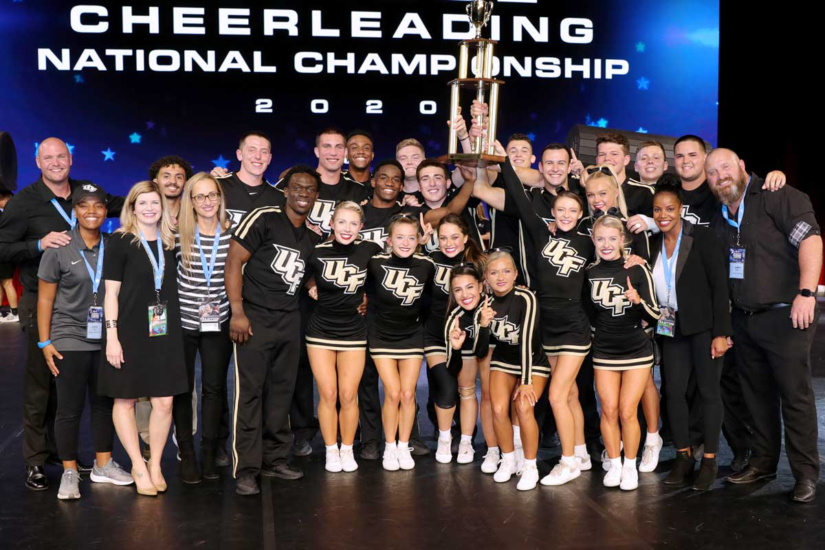 UCF cheer team poses with national championship trophy