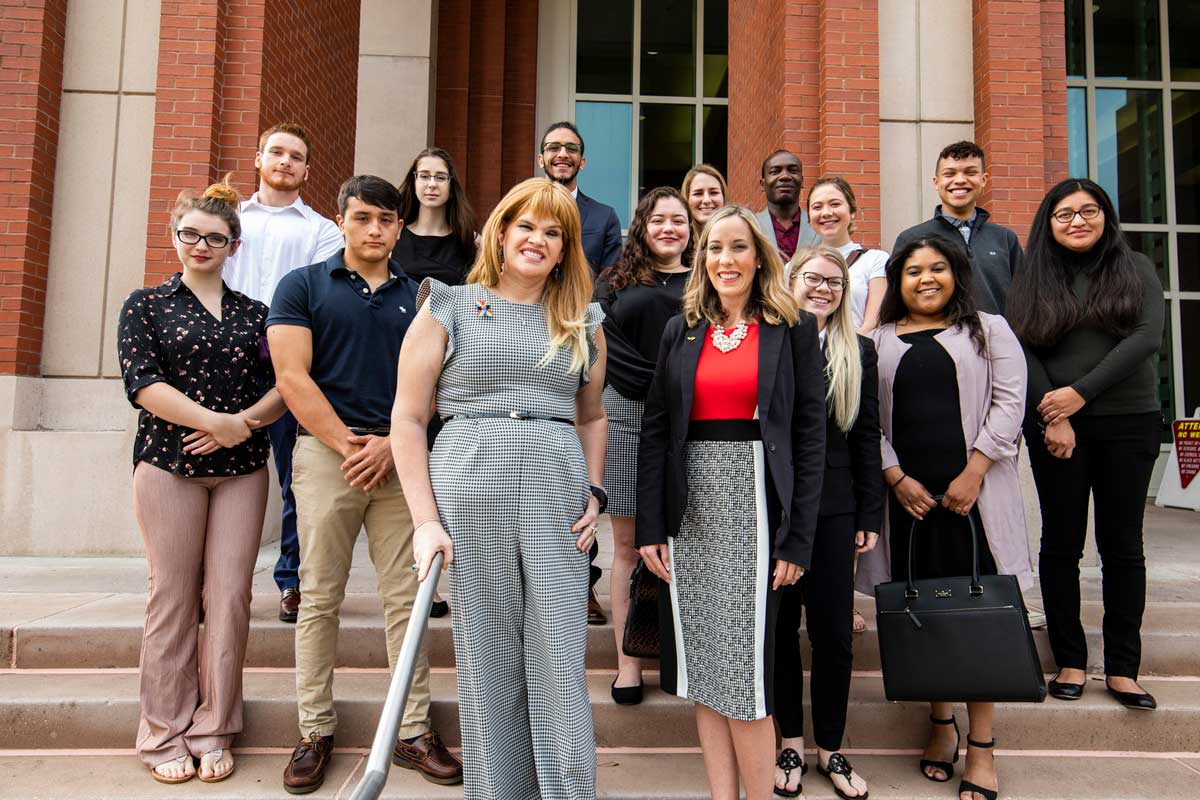 Juleigh Mayfield, Irene Pons and a group of UCF students stand on the steps of a courthouse