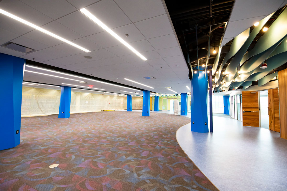 open space with blue, load bearing columns