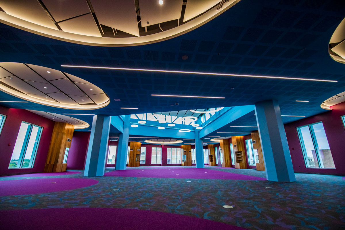 large, empty room decorated in blue and purple hues