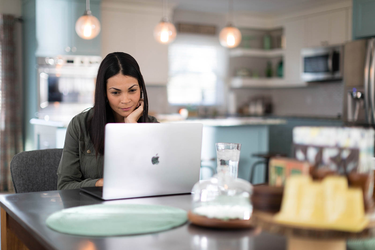 Woman looks at her laptop