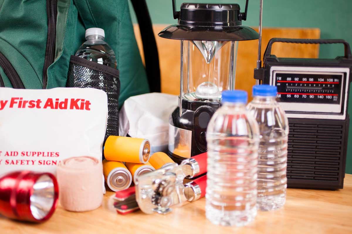 first aid kit, water bottles, radio, and other hurricane supplies